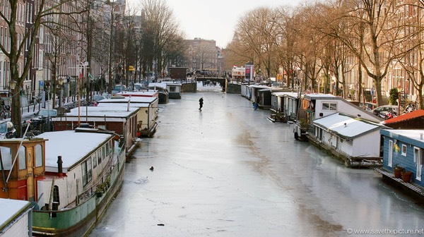 Amsterdam frozen canals, houseboats