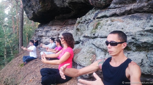 Early morning zen meditation at the edge of the cliff