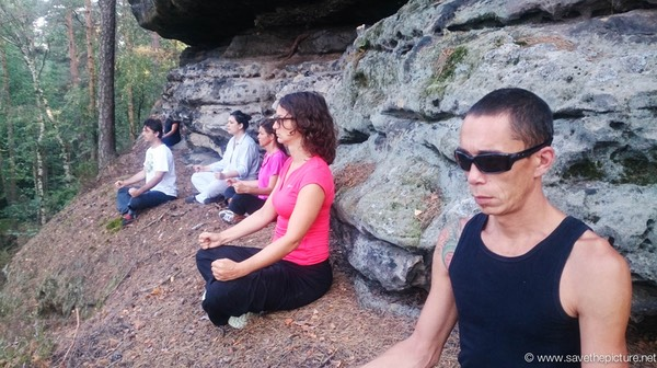 Early morning Zen meditation sitting at the edge of the clif