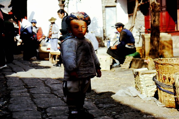 Lijiang Naxi boy in the shadow
